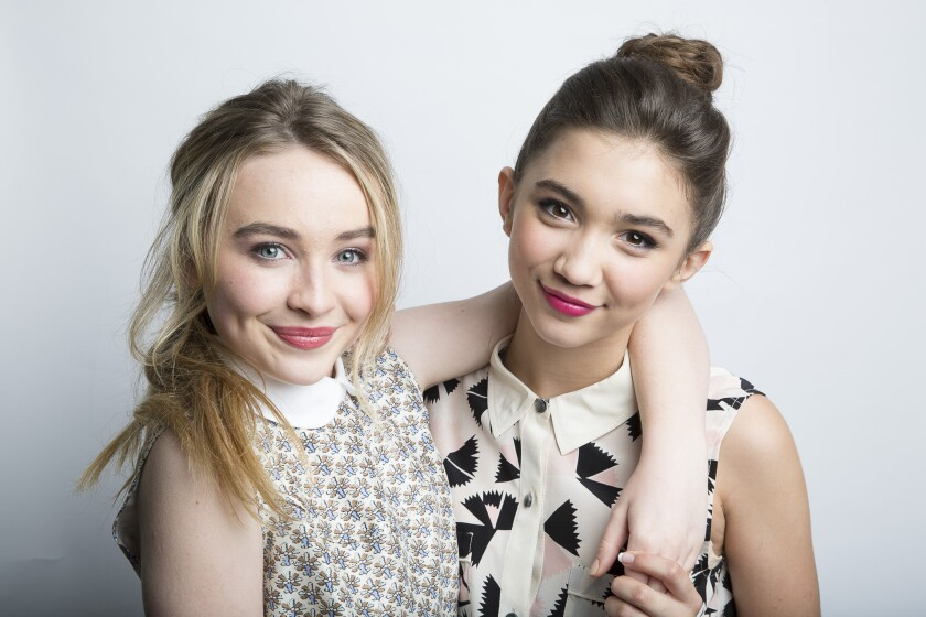 """Sabrina Carpenter, left, who plays Maya, and Rowan Blanchard, who plays Riley, of the new Disney show """"Girl Meets World"""" have inspired a clothing collection for tweens."""