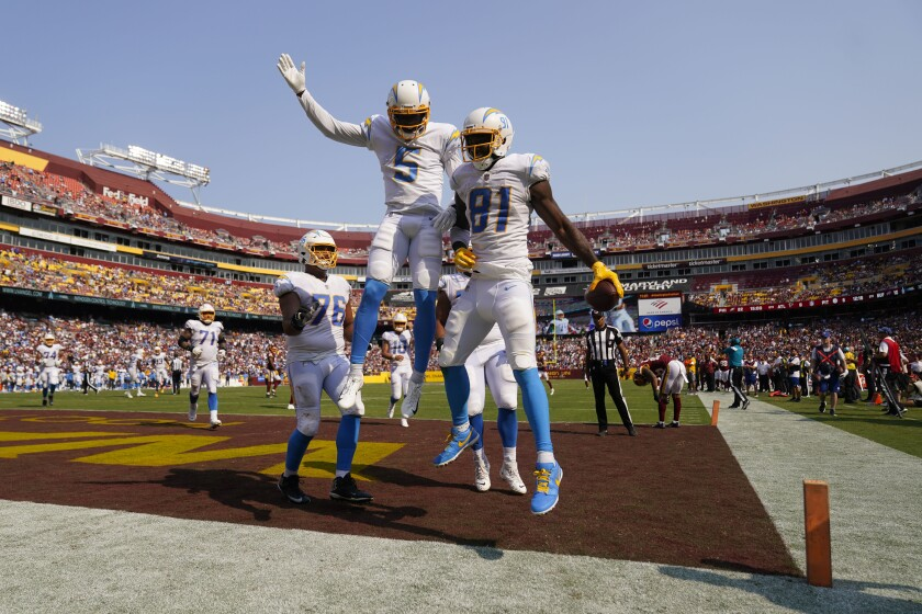 Chargers wide receiver Mike Williams (81) celebrates winning touchdown with Josh Palmer (5) on Sunday against Washington.
