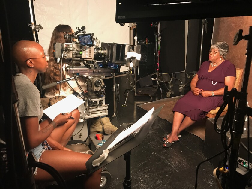 """Filmmaker Oge Egbuonu and interview subject Cora Matthews during production of the documentary '(In)visible Portraits."""""""