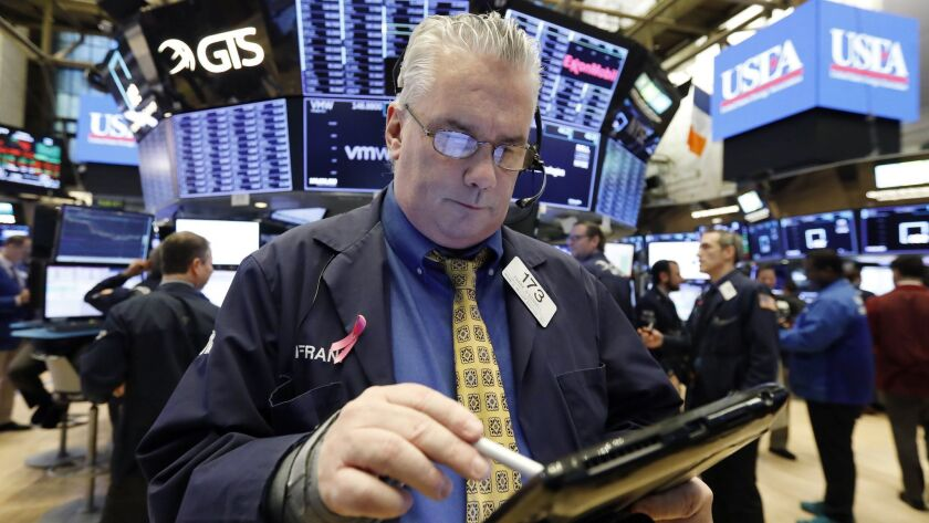 Trader Frank O'Connell works on the floor of the New York Stock Exchange on Friday.