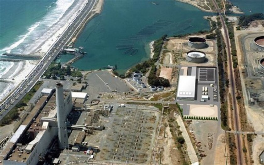 This image provided by the San Diego County Water Authority shows an artist rendering of a proposed desalination plant, center right, superimposed over an aerial photograph, in Carlsbad, Calif.  The proposed plant will be the Western Hemisphere's largest desalination plant. (AP Photo/San Diego Coun