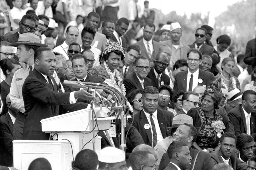 Pastor Dr. Martin Luther King Jr. speaks to thousands during his time