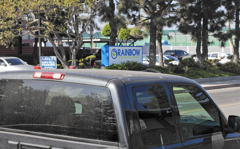 A truck parked outside Oak View Preschool in Huntington Beach sits across the street from Rainbow Environmental Services' waste transfer station at 17121 Nichols Lane.