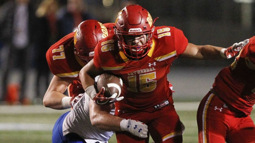 NORWALK, December 14, 2018   Cathedral Catholic's Shawn Poma carries the ball as Folsom's Tyler Hard