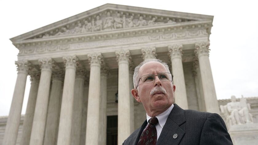 Plaintiff Mark Janus passes in front of the U.S. Supreme Court after a hearing in Washington on Feb. 26.