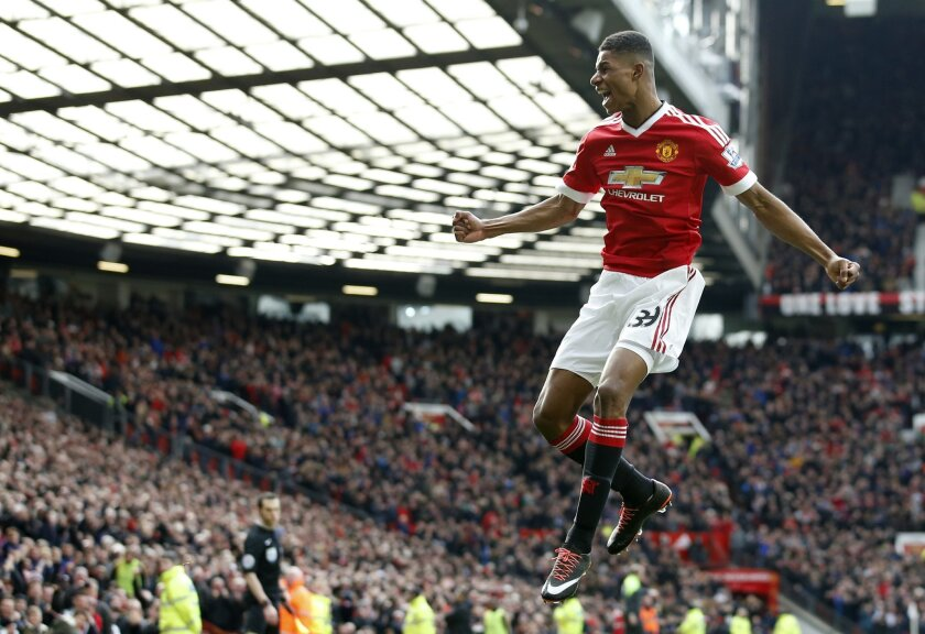 Manchester United's Marcus Rashford, celebrates after he sores the opening goal of the game during the English Premier League soccer match between Manchester United and Arsenal at Old Trafford Stadium, Manchester, England, Sunday, Feb. 28, 2016. (AP Photo/Jon Super)