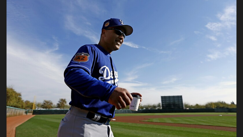 Dodgers Manager Dave Roberts arrives at the field for a spring-training practice at Camelback Ranch last month.