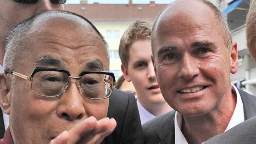"""The Dalai Lama, left, and filmmaker Hubertus Hoffmann from the documentary """"Love is Tolerance."""""""