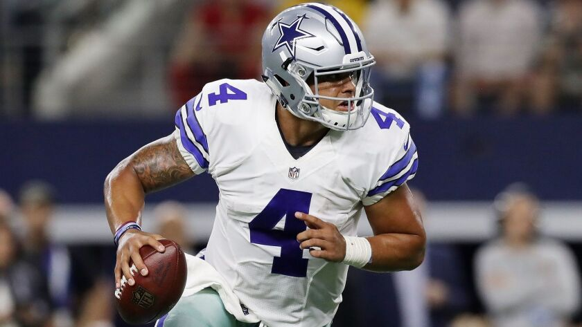 Dallas quarterback Dak Prescott scrambles against Philadelphia during a game Oct. 30.