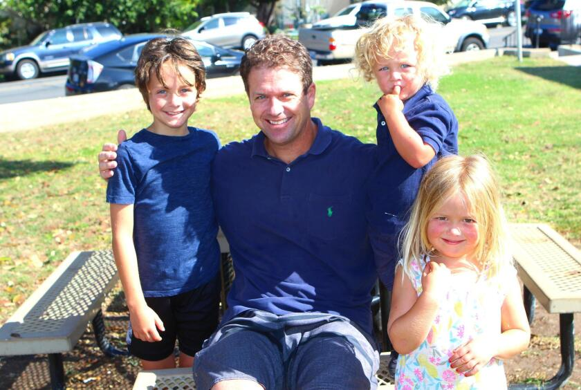 La Jollan James Patrick Rudolph is surrounded by his offspring: James Joseph, 8; Patrick Andrew, 2; and Rosie Catherine, 4.