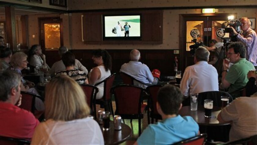 Golfers watch tv at Rory McIlroy's home club of Holywood Golf Club, situated on the outskirts of Belfast, Northern Ireland, Sunday, April, 10, 2011 as he plays  in the Masters Golf Championship in Augusta, Georgia.  (AP Photo/Peter Morrison)