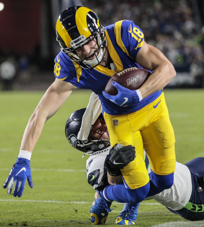LOS ANGELES, CA, SUNDAY, DECEMBER 8, 2019 - Los Angeles Rams wide receiver Cooper Kupp (18) slips the tackle of Seattle Seahawks linebacker Cody Barton (57) after a catch near the goal line on a second quarter touchdown drive at LA Memorial Coliseum. (Robert Gauthier/Los Angeles Times)