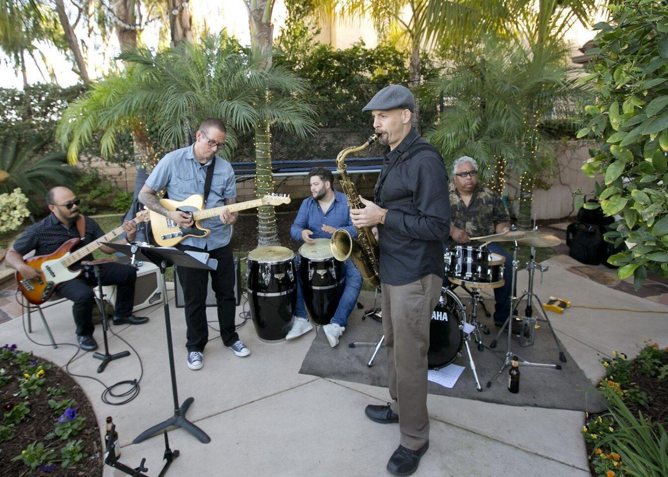 Musical entertainment was provided by Harley Magsino (bass), Nate Jarrell (guitar), Daniel Feldman (percussion), Ian Tordella (saxophone), Michael Atesalp (drums)