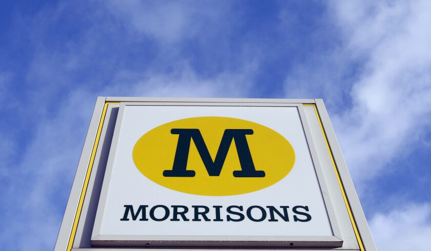 FILE - In this Thursday, Dec. 4, 2008 file photo, a view of a Morrisons sign, at a supermarket is seen in London, Thursday, Dec. 4, 2008. Morrisons, A group led by U.S.-based Fortress Investment has agreed to buy Morrisons, the U.K.'s fourth-largest supermarket chain, for 6.3 billion pounds ($8.7 billion) as overseas investors look for bargains in a market battered by Brexit and the pandemic. (AP Photo/Kirsty Wigglesworth, File)