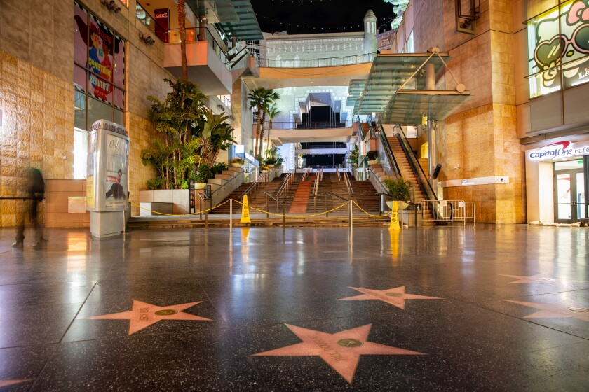 All is quiet along Hollywood Boulevard, where there is little traffic in front of a closed Hollywood and Highland complex in Hollywood, CA — where the Academy Awards are annually held — on March 20, 2020.