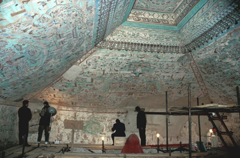 The Mogao Grottoes, a vast network of 492 caves in China, are covered with Buddhist murals. Exact replicas of three of the painted caves will come to the Getty Center in a 2016 show that also will include artifacts from the caves.
