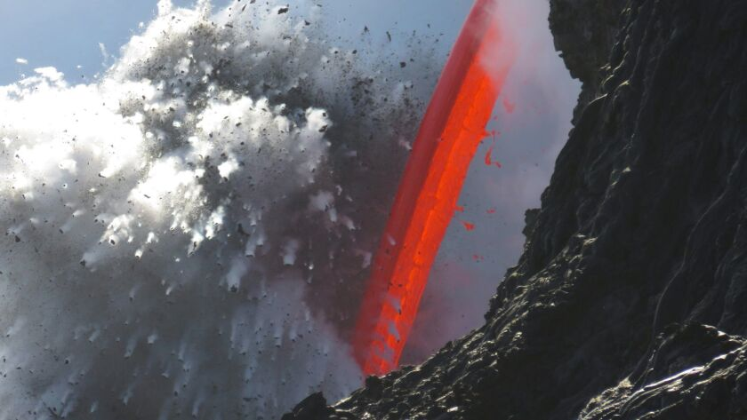 "A ""fire hose"" flow stream from a lava tube from Kilauea volcano Feb. 1 at Hawaii Volcanoes National"