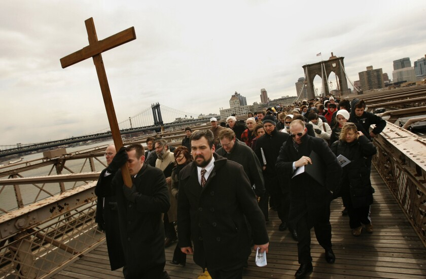 Worshipers in Brooklyn take part in the annual Way of the Cross procession on Good Friday.