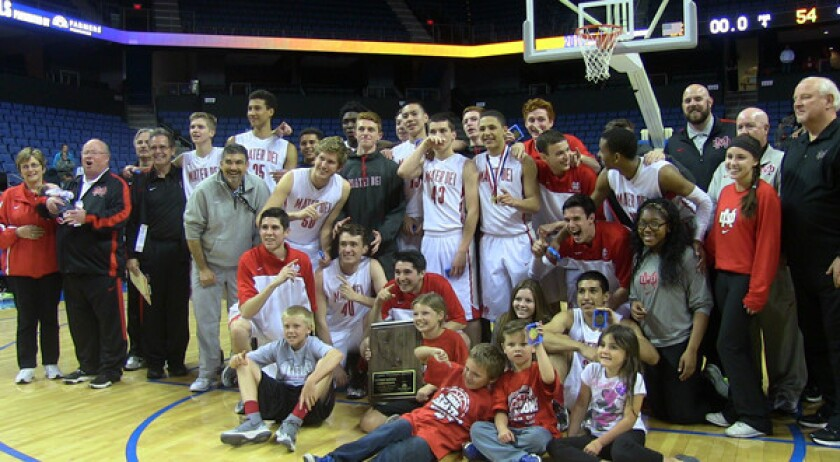 Mater Dei players, coaches, fans and family members celebrate the team's Southern California Regional Open Division title victory over Westchester at Citizens Business Bank Arena in Ontario on Saturday.