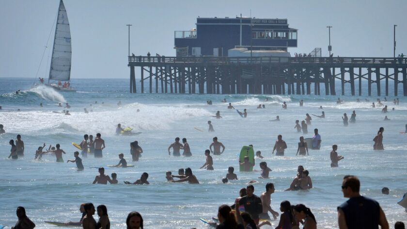 Students in the Newport-Mesa Unified School District could get a chance to hit the beach earlier on hot days if the district decides to implement minimum school days during sweltering weather.