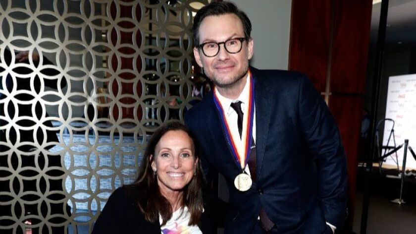 Paralympic athlete Candace Cable and actor Christian Slater attend Gold Meets Golden event.