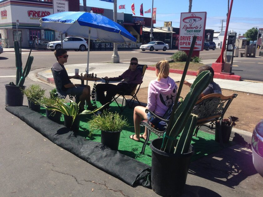 A lively chess game proceeds at a parklet on Everts Street at Garnet Avenue in Pacific Beach.