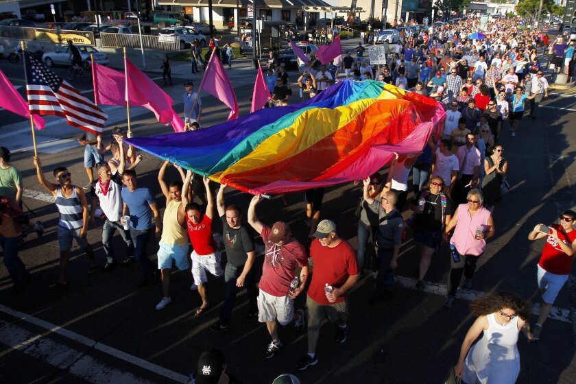 Supporters of same-sex marriage marched down University Ave. in Hillcrest after the U.S. Supreme Court ruling cleared the way for same-sex marriage in California on Wednesday, June 26, 2013.