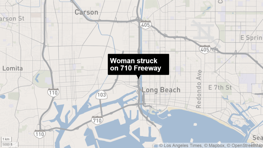 A woman was struck and killed on the northbound 710 Freeway north of Anaheim Street early Sunday.