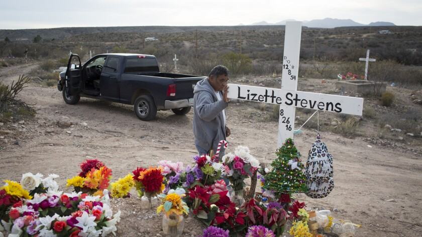 Mike Stevens visits the grave of his late wife, Lizette, on the reservation. Lizette's mother, sister and aunt died within a few years of one another in the 1980s and 1990s.
