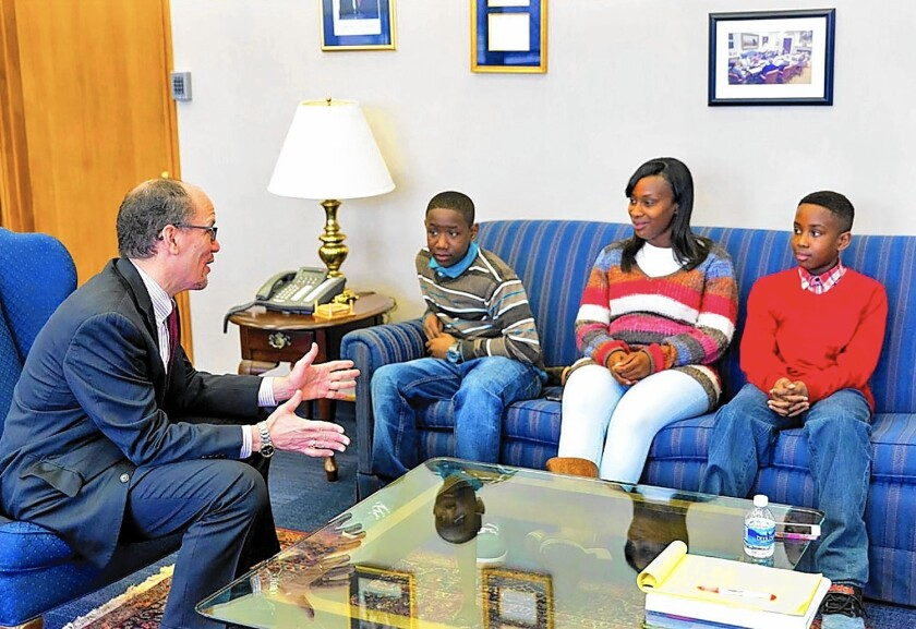 LeDaya Epps and her two sons meet with U.S. Labor Secretary Thomas Perez in Washington. Epps attended the State of the Union address Tuesday as a guest of First Lady Michelle Obama.