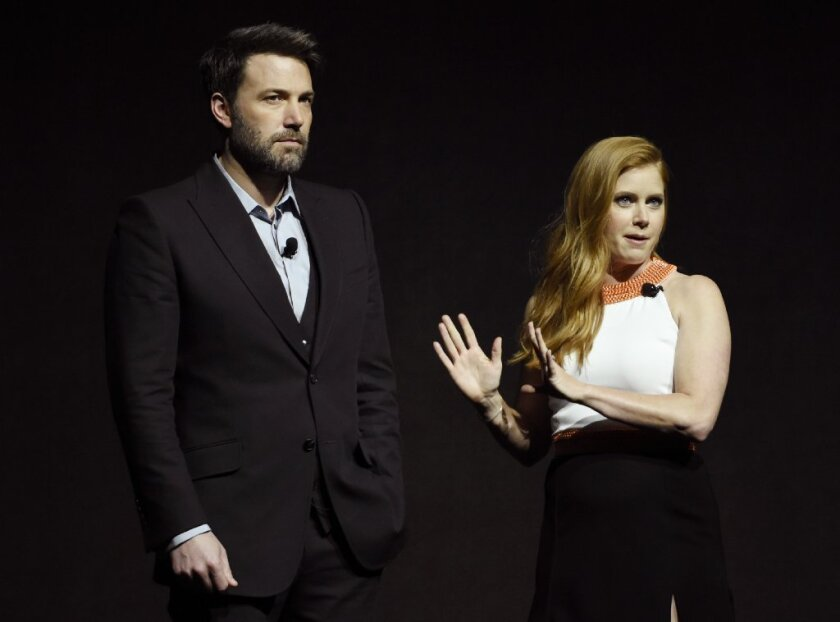 Stars Ben Affleck and Amy Adams address the audience during the Warner Bros