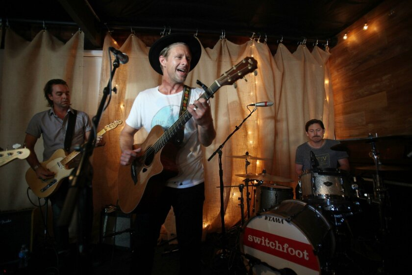 Jon Foreman of the group Switchfoot performed at 25 stops throughout coastal cities in the county as part of a 24-hour musical marathon benefitting his nonprofit music studio Bro-Am in Encinitas. At left on guitar is Drew Shirley, and at right on drums is Chad Butler.