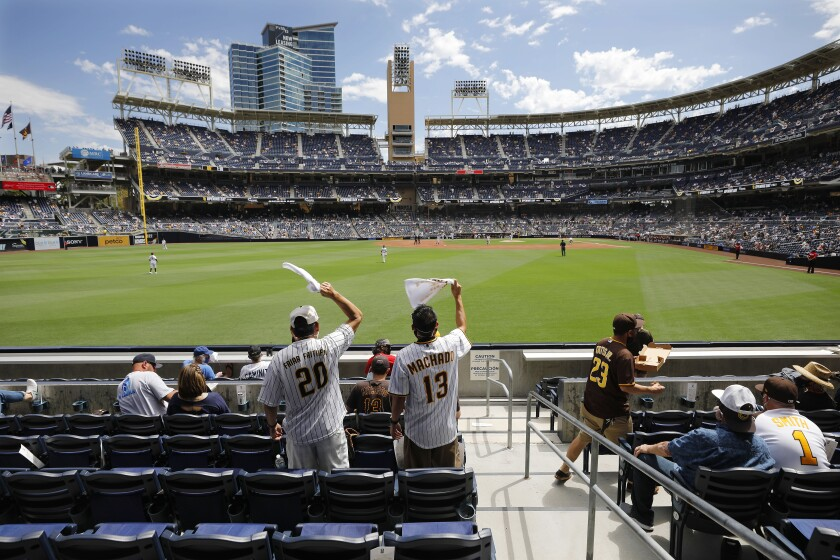 Fans cheer on the San Diego Padres while playing the Arizona Diamondbacks on opening day at Petco Park.