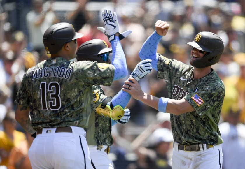 Wil Myers is congratulated by Manny Machado after scoring