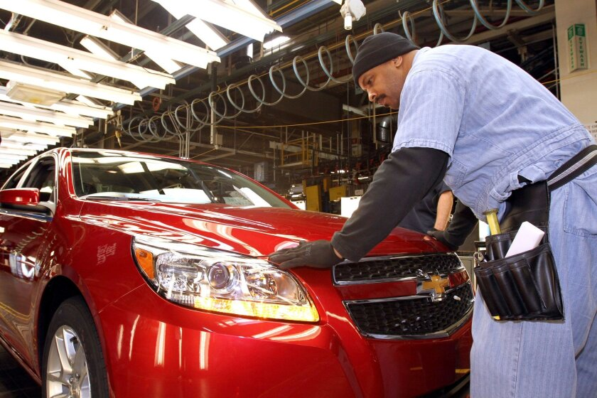 A General Motors employee checks the fit and finish of a 2013 Chevrolet Malibu Eco at the Fairfax plant.