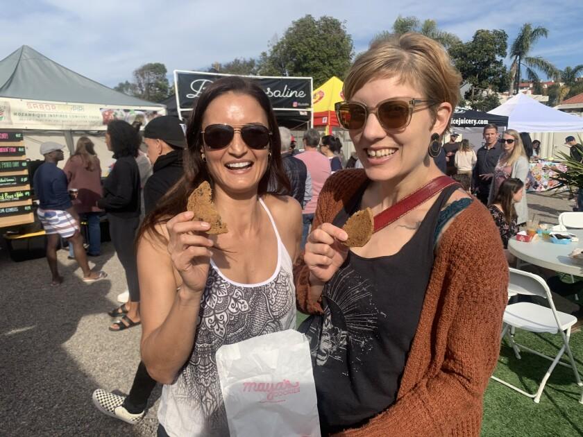 Guests enjoy vegan cookies at a past event.