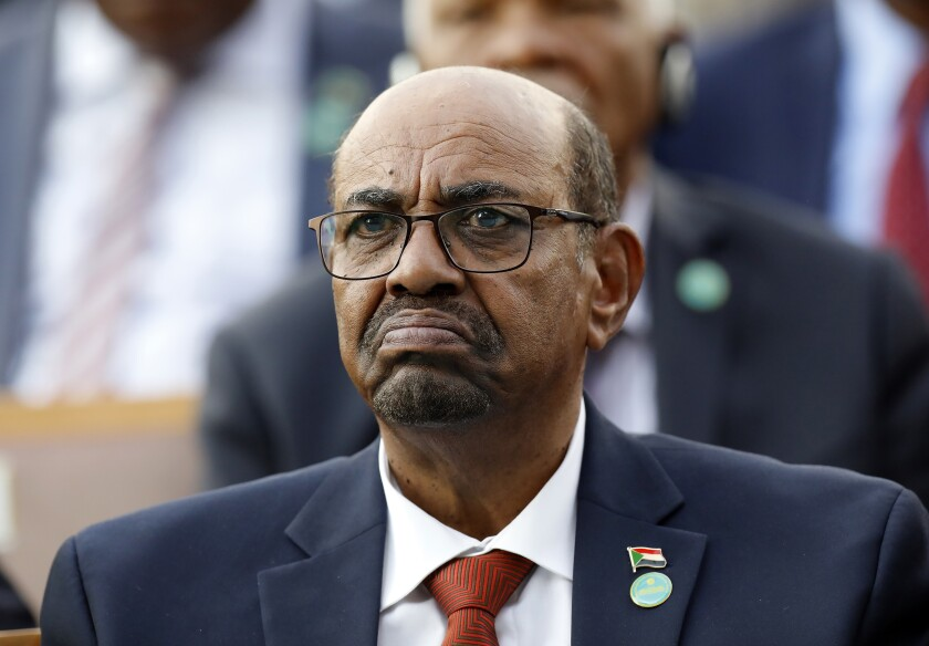 In this July 9, 2018, file photo, Sudan's President Omar al-Bashir attends a ceremony for Turkey's President Recep Tayyip Erdogan, at the Presidential Palace in Ankara, Turkey. On Saturday, Dec. 14, 2019, a Sudan court convicted al-Bashir of money laundering, sentences him to 2 years in rehabilitation facility. (AP Photo/Burhan Ozbilici, File)