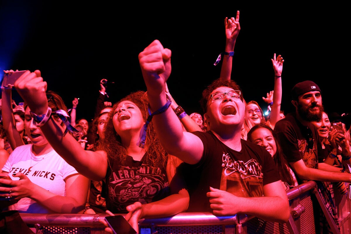 From left to right, Dinneh Estrada, 18, of Huntington Beach and Alex Lievanos, 19, of San Diego sing along to Aerosmith during day 2 of KAABOO Del Mar on Sept. 16, 2016. (Misael Virgen/Union-Tribune)