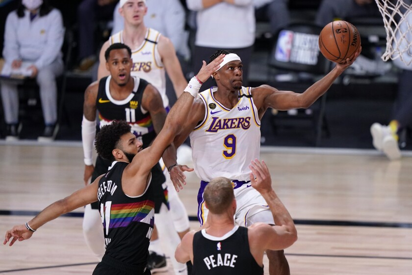 Lakers guard Rajon Rondo scores on a layup against the Nuggets during Game 3 on Sept. 22, 2020.