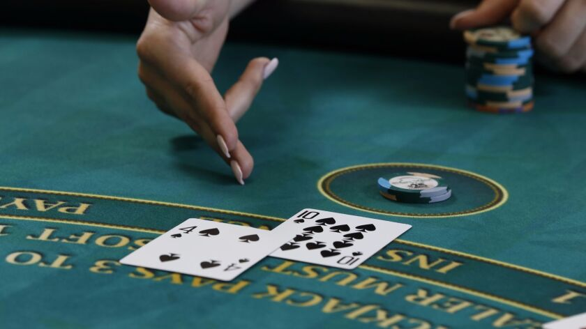 Hit me! An important part of learning how to play blackjack is to know the hand signals players are