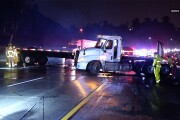 Semi truck jack knifes in the rain blocking the entire 15 freeway