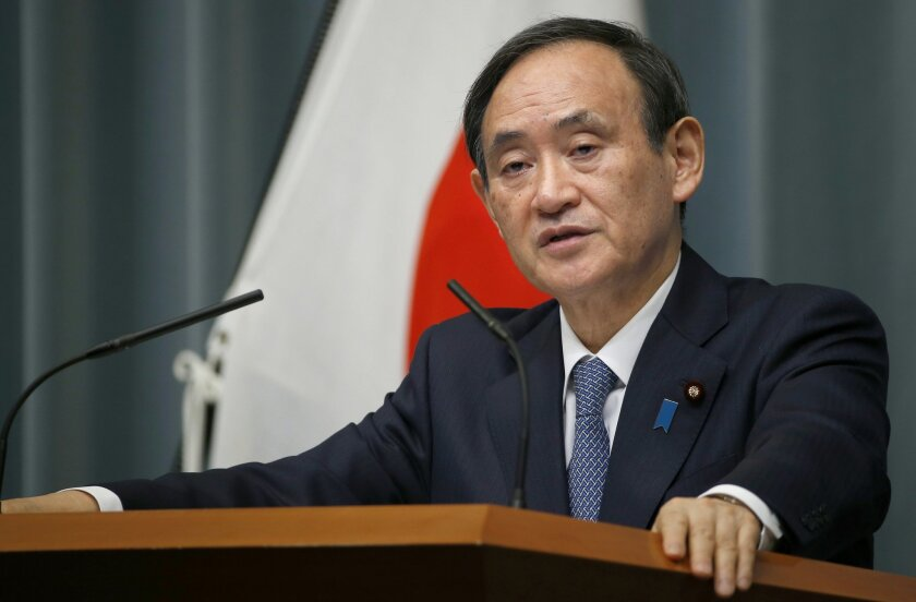 Japan's Chief Cabinet Secretary Yoshihide Suga speaks to the media during a press conference at Prime Minister's official residence in Tokyo, Wednesday, Feb. 10, 2016. Japan announced Wednesday that it will impose new sanctions on North Korea to protest a rocket launch seen as a test of missile tec