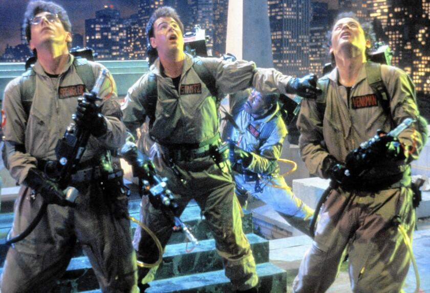 "Harold Ramis, left, Dan Aykroyd and Bill Murray in a scene from ""Ghostbusters."""