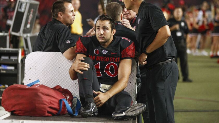 San Diego State quarterback Christian Chapman is taken away by cart after he was injured during the second quarter against Sacramento State at SDCCU Stadium.