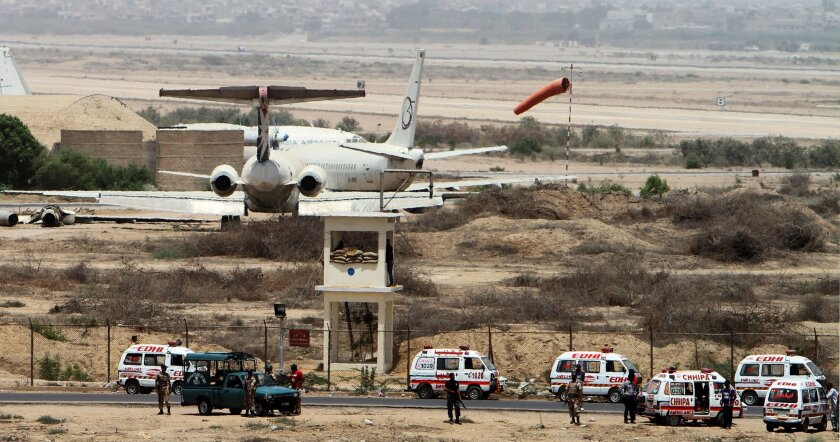 Pakistani security personnel guard the Karachi International Airport in Pakistan, Tuesday, June 10, 2014. Gunmen attacked a training facility near the Karachi airport Tuesday, a spokesman said. The facility is about one kilometer (a half-mile) from the airport. (AP Photo/Fareed Khan)