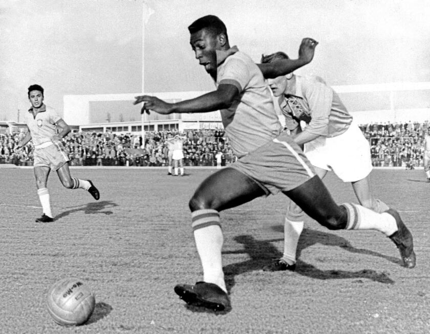 Picture dated 08 May 1960 shows Brazilian soccer star Edson Arantes do Nascimento, better known as Pele, during a match Brazil vs Sweden. The national olympic committees named Pele (soccer), Muhammad Ali (boxing), Carl Lewis (athletics), Michael Jordan (basketball) and Mark Spitz(swimming) the five sportsmen of the century it was reported in a International Olympic Committee statement 17 December 1999.