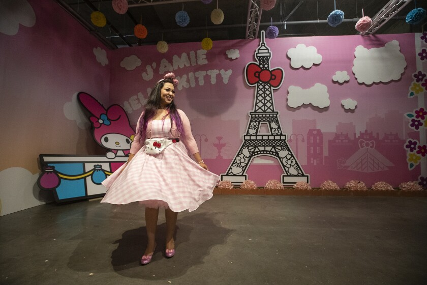 Faheema Chaudhury of Northridge goes for a spin inside the Paris room at the Hello Kitty Friends Around the World Tour pop-up.