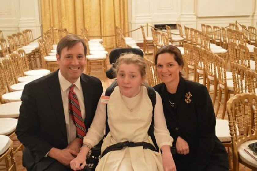 Lilly Grossman with her parents, Steve and Gay Grossman, at the White House