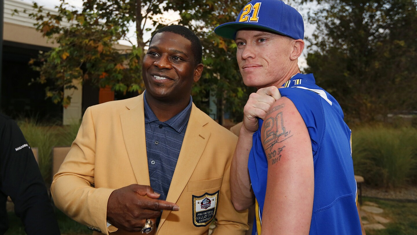 Former Chargers running back LaDainian Tomlinson takes a photo with fan John Kegley, who had a #21 HOF tattoo, during LT's San Diego Homecoming Celebration on August 27, 2018. (Photo by K.C. Alfred/San Diego Union-Tribune)