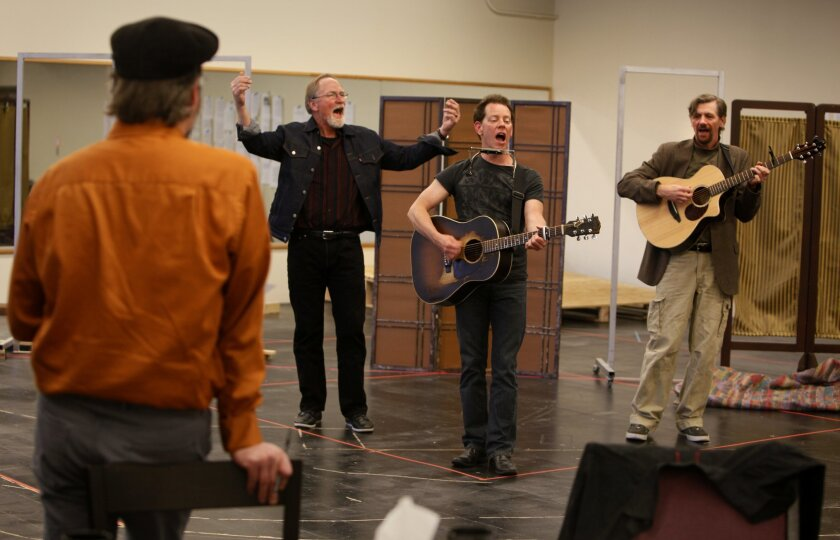 "Director-writer Todd Salovey observes as Vaughn Armstrong, Dave Crossland and Jim Mooney (left to right) rehearse a scene from San Diego Rep's ""A Hammer, a Bell, and a Song to Sing."""